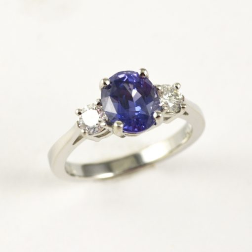 Earthwise Jewelry Trixie engagement ring set with a 2 carat purple sapphire and two side Canadian diamonds.