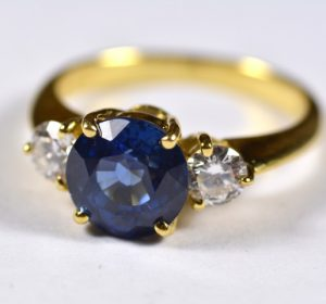 Vintage Leber Jeweler blue sapphire and diamond three stone ring.