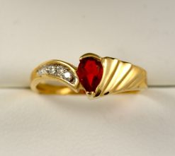 Leber Jeweler fire opal and diamond ring