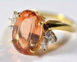 Leber Jeweler precious topaz and diamond ring side view