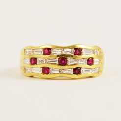 Leber Jeweler 18k yellow gold baguette diamond and ruby wave style band.