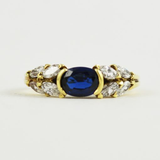 18k yellow gold oval blue sapphire and marquise cut diamond ring