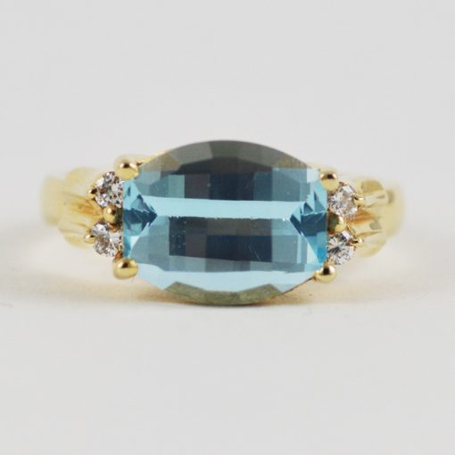 Leber Jeweler yellow gold checkerboard cut blue topaz ring